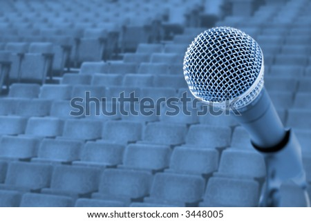 Before A Conference/Concert  (Microphone In Front Of Empty Chairs) - stock photo