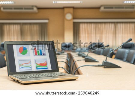 Before a conference,Laptop in front of empty chairs at conference room - stock photo