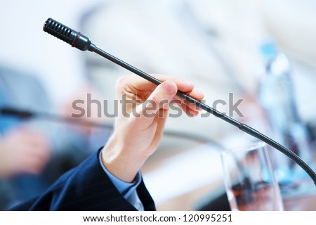 before a conference, the microphones in front of empty chairs. - stock photo
