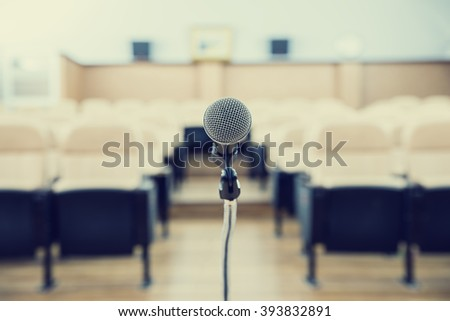 before a conference, the microphones in front of empty chairs.(color tone image)