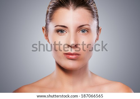 Before and after. Portrait of beautiful mature woman with half face make-up standing against grey background