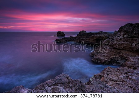 Before sunrise. Magnificent sunrise view in the blue hour at the Black sea coast, Bulgaria. - stock photo