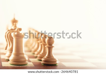 Before the battle - white chess pieces standing on a chessboard  - stock photo
