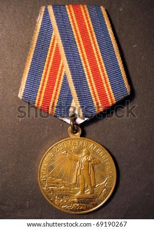 Before the medal, memorable medal 250 years Leningrad on black background in USSR. - stock photo