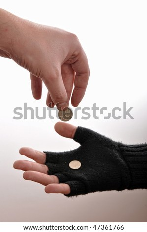 Beggar hand with coins, image is isolated on white background. - stock photo