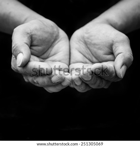 Beggar people and human poverty concept - person hands begging f - stock photo