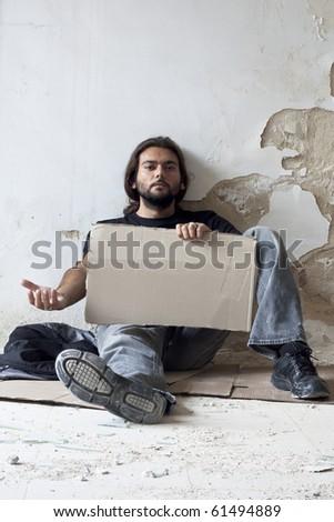 Beggar Sitting on the Floor - stock photo