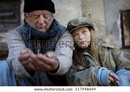 Begging people for food - stock photo