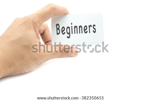 Beginners message on the card hand in hand on white background