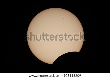 Beginning of Annular Eclipse of May 20 2012, captured at Journal Pavilion in Albuquerque, NM - stock photo
