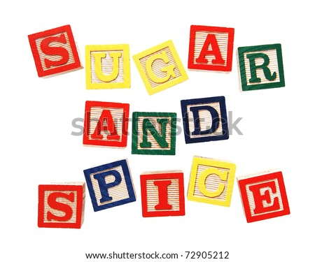 "beginning of old nursery rhyme ""sugar and spice and everything nice, that's what little girls are made of"" written in colorful wooden blocks, isolated on white"