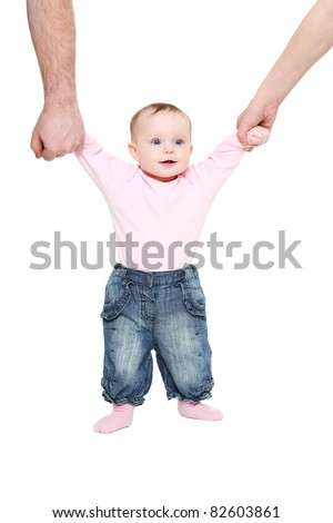 Beginning to go the child keeps for hands of parents - stock photo
