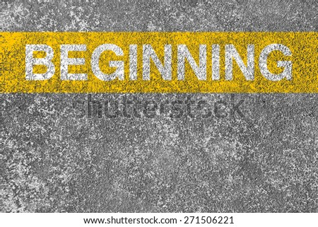 Beginning yellow line is on the asphalt road. - stock photo