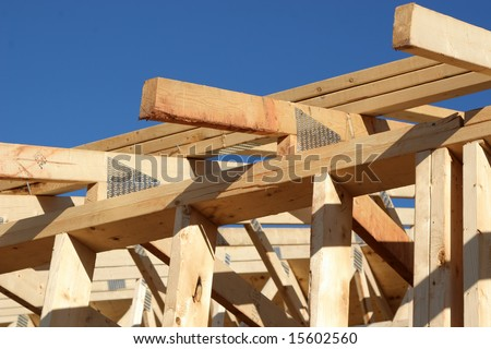 Beginnings of a new roof on a house or building. - stock photo