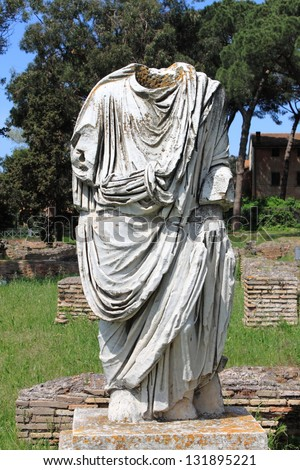 Beheaded statue of a roman senator in Ostia Antica, the old harbour of Rome, Italy - stock photo