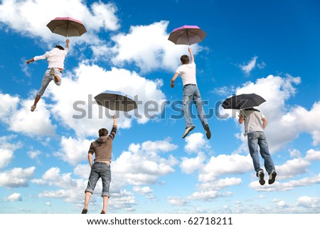 behind flying four friends with umbrellas on White, fluffy clouds in blue sky collage - stock photo