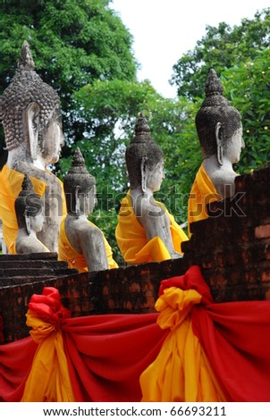 Behind the Buddha images in Ayuthaya Thailand - stock photo