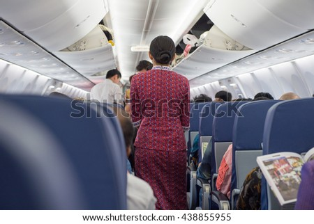 Behind the flight attendants on the plane - stock photo
