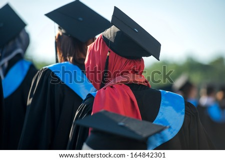 Behind view of muslim woman on a graduating ceremony