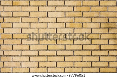Beige brick wall - stock photo