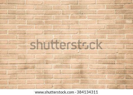 Beige-brown grunge brick wall texture or dirty surface pattern for background and backdrop, architectural element in urban concept, retro or vintage style - stock photo