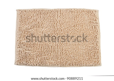 Beige carpet or doormat for cleaning feet - stock photo