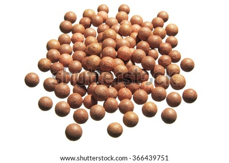 Beige cosmetics rouge balls on white background