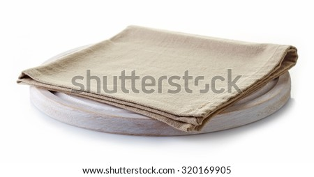 Beige cotton napkin on a white cutting board isolated on white background - stock photo