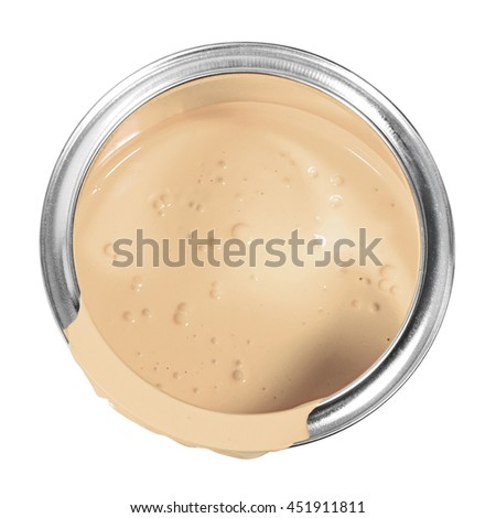 Beige cream paint can isolated on a white background.