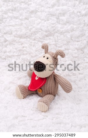 Beige crocheted bear with heart - stock photo