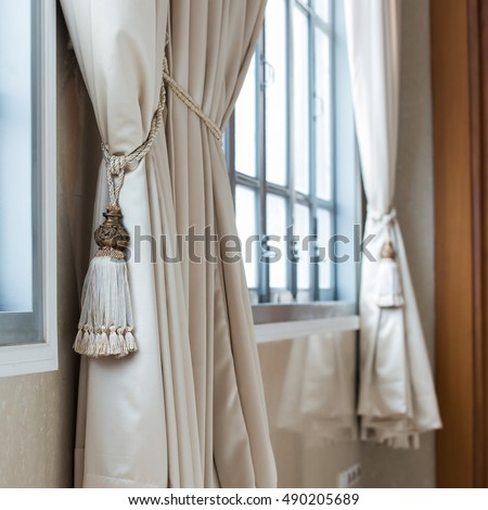 Beige curtains in a classic style. Interior