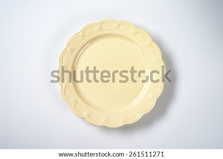 beige decorative plate on white plate - stock photo