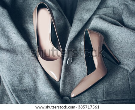 beige fashionable shoes and clothing - stock photo