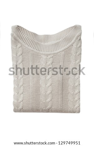 Beige folded sweater isolated on white