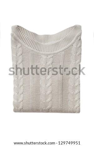 Beige folded sweater isolated on white - stock photo