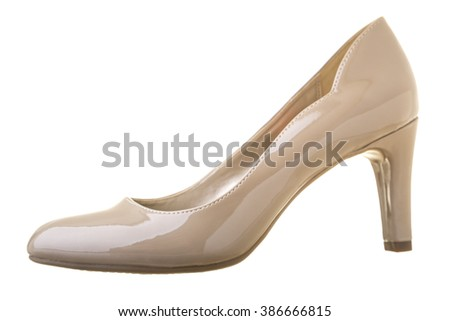 Beige high heel shoe isolated on white - stock photo