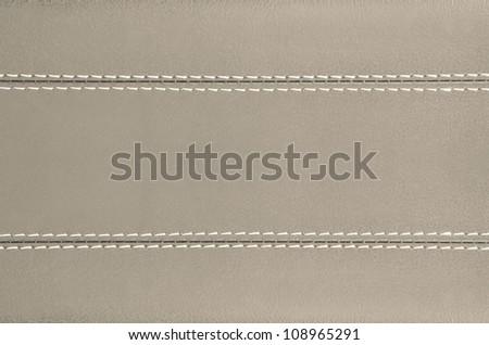 beige  horizontal stitched leather background , art wallpaper - stock photo