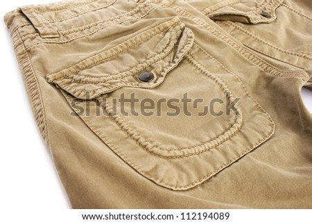 Beige jeans on white background. - stock photo