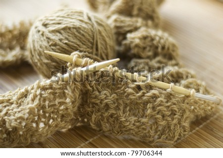 beige knitting and wool yarn - stock photo