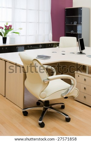 Beige leather armchairs at modern new office - stock photo
