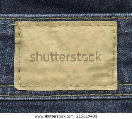 beige leather label on jeans background - stock photo