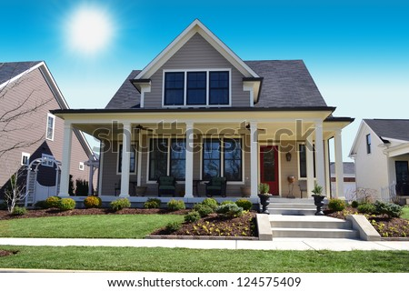 Beige New England Style Suburban Dream Home - stock photo