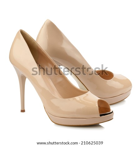 Beige patent high heel women shoe isolated on white background. - stock photo