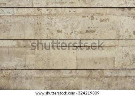 Beige peeled brick wall.  - stock photo