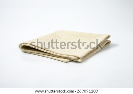 beige place mat on white background - stock photo