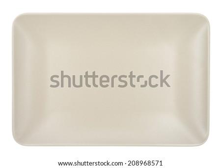 Beige rectangular plate isolated on white background. - stock photo