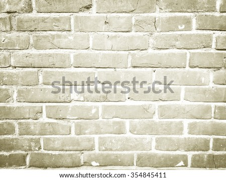 beige sepia colored cement block wallpaper background texture:brick wall backdrop for home,room,interior,design,decorate:yellow cream vintage tone color of stucco concrete.vignette display concept. - stock photo