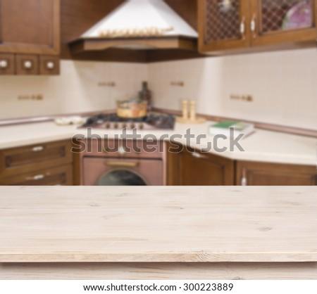 Beige table on defocused brown kitchen interior background - stock photo