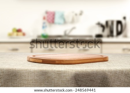 beige tablecloth and desk of wood space  - stock photo