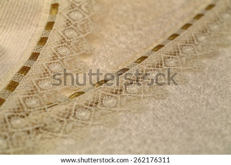 Beige terry towels with lace edging and gold braid, close up - stock photo